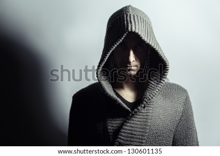 Mysterious boy with hood. - stock photo