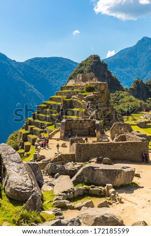 Mysterious city - Machu Picchu, Peru,South America. The Incan ruins and terrace. Example of  polygonal masonry and skill - stock photo