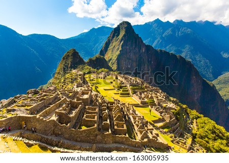Mysterious city - Machu Picchu, Peru,South America. The Incan ruins. Example of  polygonal masonry and skill - stock photo