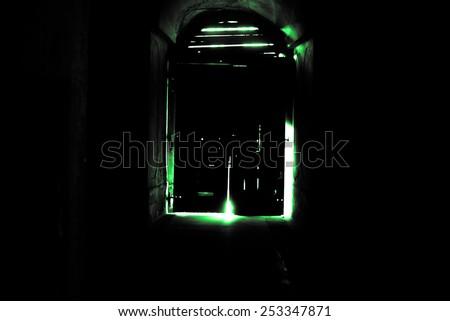 Mysterious door, secret entrance or exit green light - stock photo