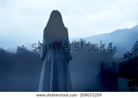 Mysterious Female Ghost in White Dress - stock photo