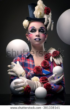 mysterious female jester Masquerade  character  juggling balls - stock photo