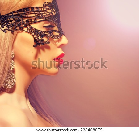 mysterious girl in a carnival mask. - stock photo