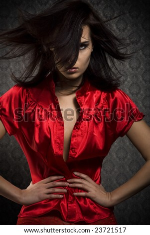 mysterious girl in red skirt - stock photo