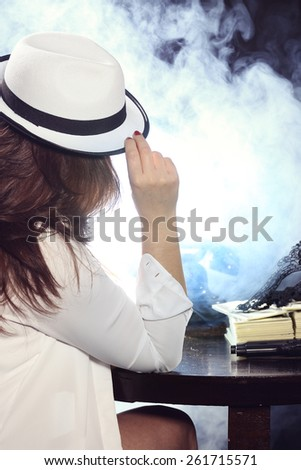 Mysterious girl in the hat - stock photo