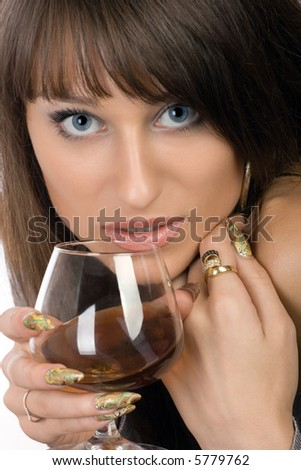 Mysterious girl with a glass of brandy