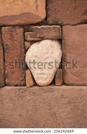 Mysterious Head in Semi-Underground Temple, Tiwanaku, Bolivia - stock photo