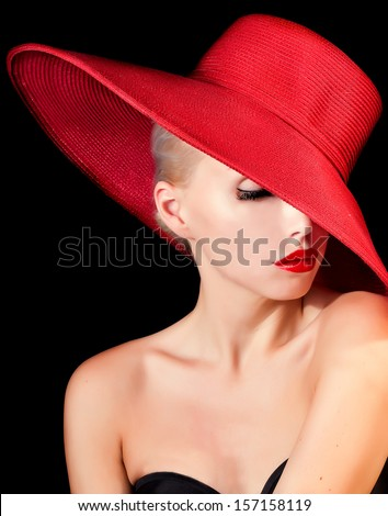 mysterious lady in red hat with red lips . - stock photo