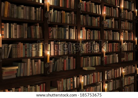 Mysterious library with candle lighting. Ancient/antique Two-storied Bookshelf. - stock photo
