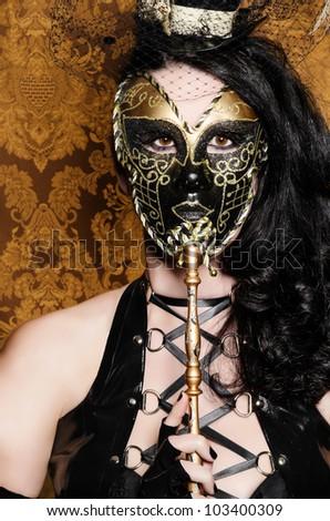 Mysterious Masquerade - Sexy Vixen with Venetian Mask - stock photo