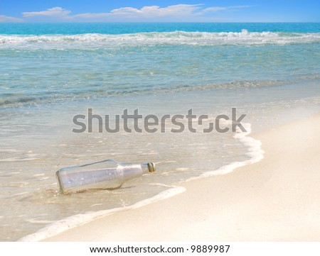 Mysterious message in a bottle washed up on gorgeous beach - stock photo