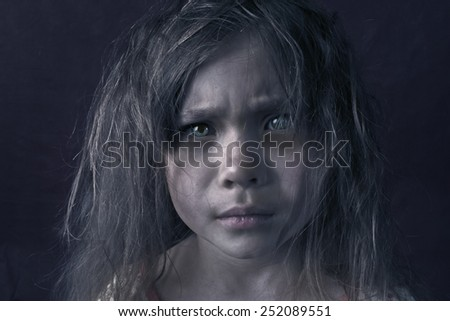 Mysterious mystic girl with red hair, dirty and grubby - stock photo