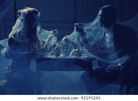 Mysterious photo of a couple drinking coffee - stock photo