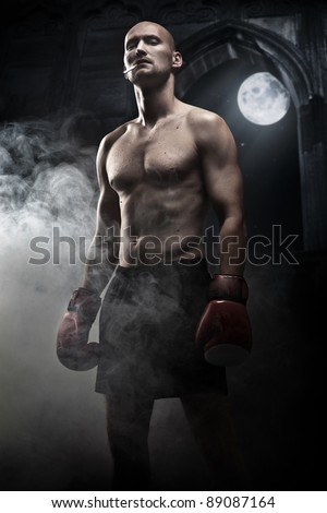 Mysterious photo of a handsome boxer - stock photo