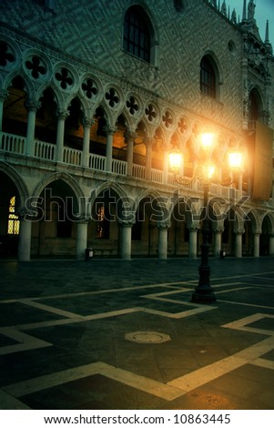 Mysterious plazza arcade in the evening in Venice, a mysterious light give you a sign, will you follow it? - stock photo