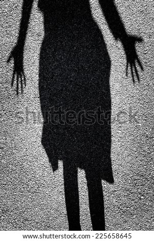 Mysterious shadow of a female figure standing in a doorway - stock photo
