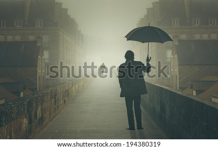 Mysterious shadow waiting in the fog a business man . Weird and surreal - stock photo
