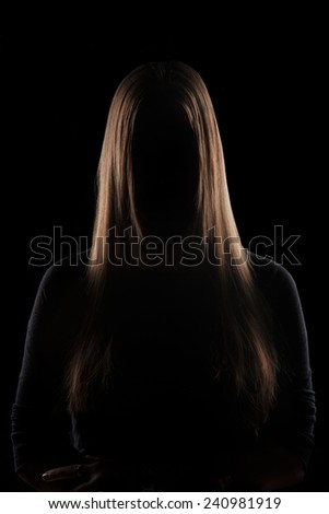 Mysterious Subject, Beautiful Hair Young woman silhouette with beautiful blonde hair - stock photo