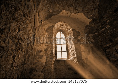 Mysterious window in the dark ancient castle - stock photo