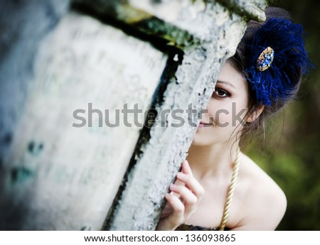 Mysterious woman dressed in scenic fashion clothes. - stock photo