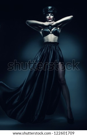 mysterious woman in black hat and bra - stock photo