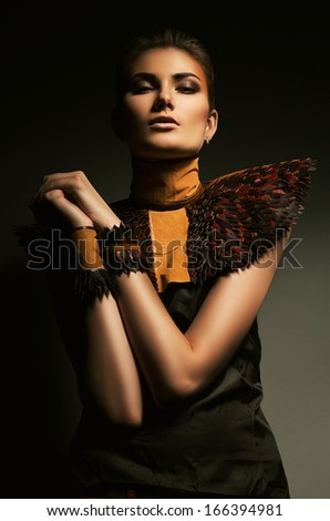 mysterious woman in leather accessory - stock photo