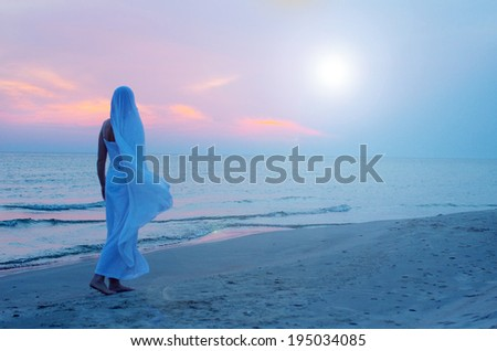mysterious woman near the sea at night  - stock photo