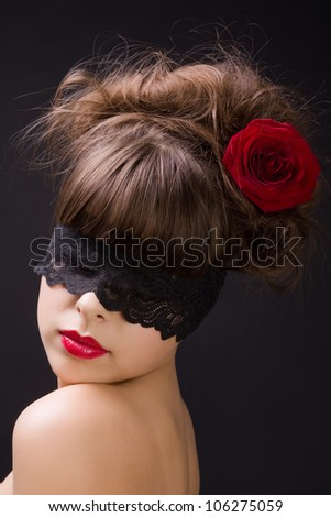 Mysterious woman wearing black lace mask