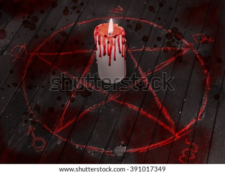 Mystic candle with bloody drops in pentagram circle on wooden table. Black magic ritual. Occult and esoteric symbols. Scary Halloween collage - stock photo