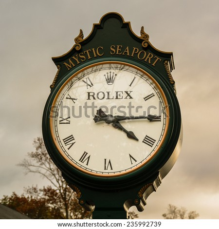 Mystic, Connecticut - October 23, 2014: Rolex outdoor clock on Oct. 23, 2014. Rolex is a luxury watch brand, generating revenues of about US$7.4 billion in 2012. - stock photo