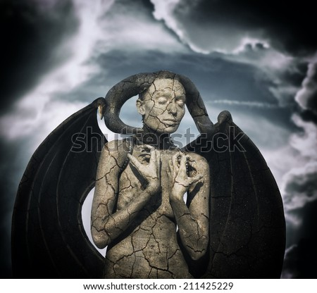 Mystic creature - woman in body paint with wings and horns, stormy sky background - stock photo