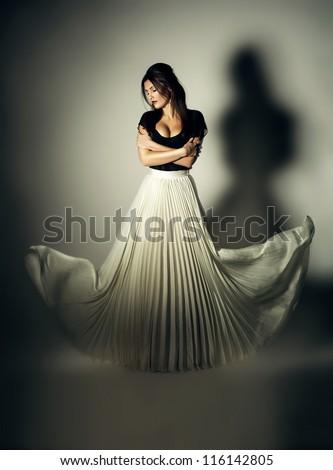 mystic dark woman with flying white skirt - stock photo