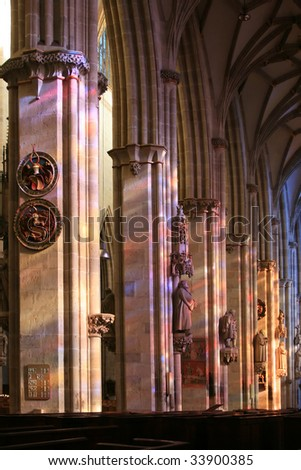 mystic light in gothic cathedral interior with stained glass - stock photo