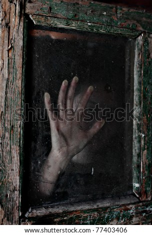 mystic photo the woman's hand on the dirty old glass - stock photo