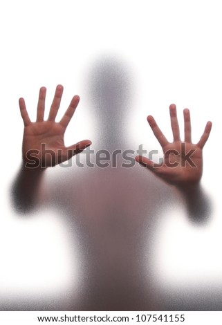 Mystic silhouette of man against the transparent wall - stock photo