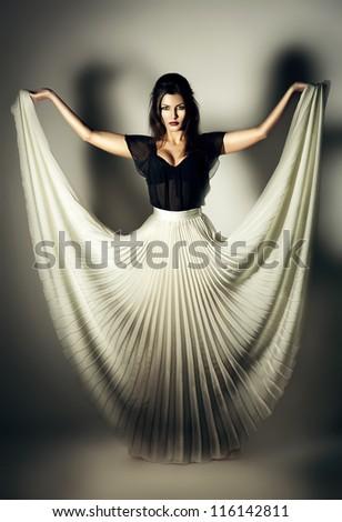 mystic woman in white skirt - stock photo