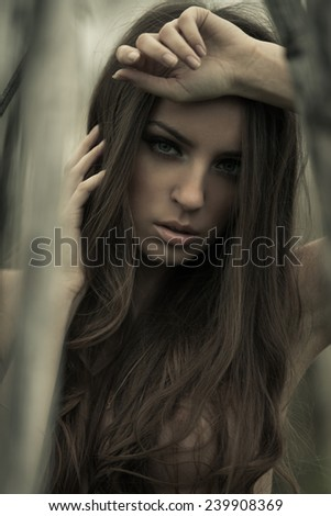 Mystical dark portrait of the beautiful girl - stock photo