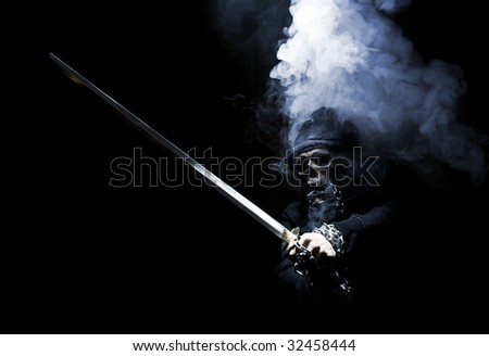 mystical fighter with sword in smoke - stock photo