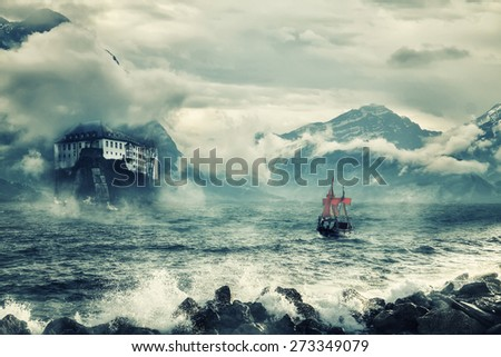 Mystical landscape with peaks of mountains and the sea. - stock photo