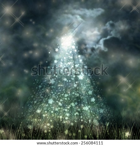 Mystical moonlight flowing from the dark sky to the ground  - stock photo