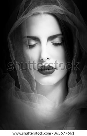 mystical woman beauty portrait with veil, studio shot, closeup, black and white - stock photo