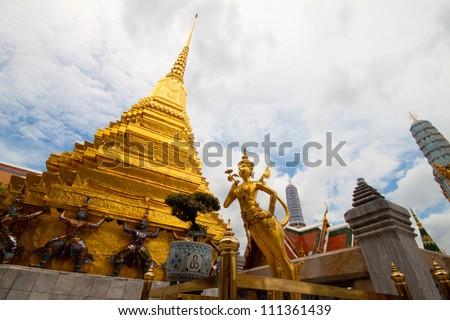 Mythical female bird with a human head gold and Carrying a giant pagoda  in wat pra sri rath tha na sard sa da ram in bangkok , thailand - stock photo