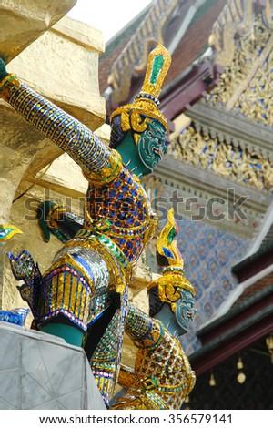 Mythical figures at Wat Phra Kaew the Grand Palace, Bangkok, Thailand.        - stock photo