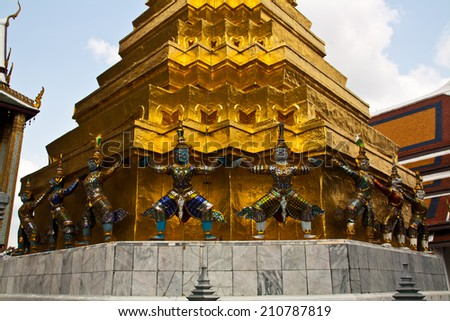 Mythical Giant Guardian Statue under The Golden Stupa - stock photo