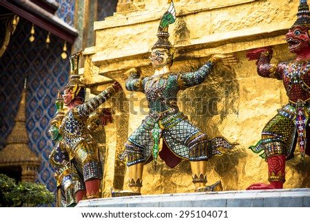 Mythical Giants and the Golden Pagoda in the Temple of Emerald Buddha - stock photo