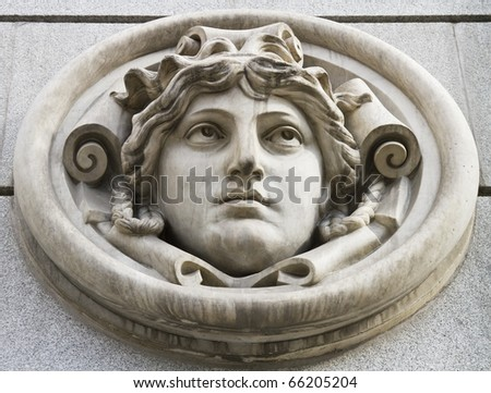 Mythological face (marble) on wall, in Madrid