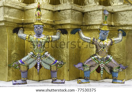 Mythological figure of the ramayana, the demon guardian, guarding the buddhist temple in The Grand Palace, Bangkok Thailand
