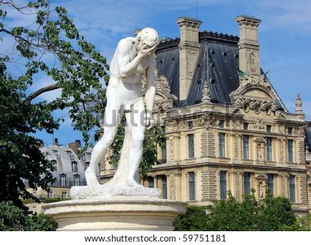 mythological sculpture in park of paris - stock photo