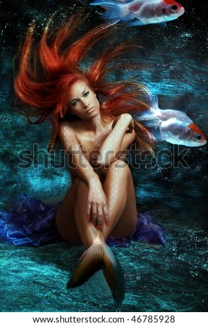 mythology being, mermaid with red floating hair - stock photo