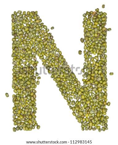 N,alphabet form green beans on white. - stock photo